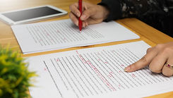 hand working on paper for proofreading.j