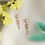 Thumbnail: Crystal Sun Flower Dangle Earrings - MOOII