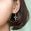 Thumbnail: Sterling Silver Hollow Out Starburst Cross Earrings