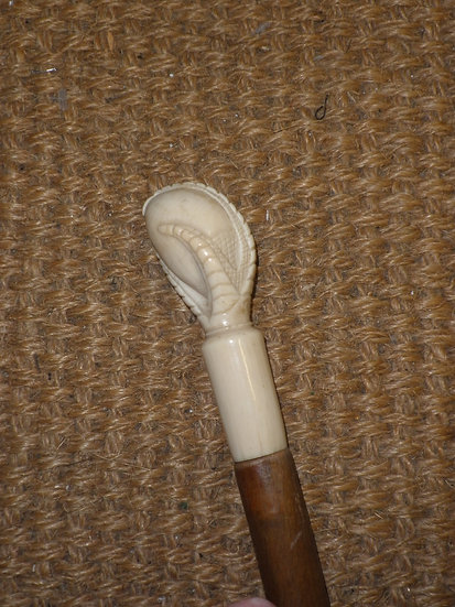 Antique Carved Walking Stick With Bone Bird Talon Clutching Egg Top