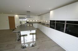 Autumnwood Kitchens - Handless in white gloss - Holmer Green 6