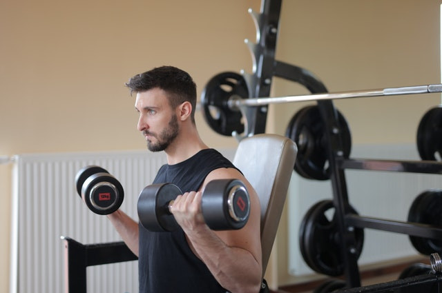 Person Doing incline dumbbell curls