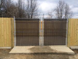 Fence Contractor. Dumpster enclosure.