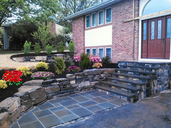 Bluestone stairs and boulder wall.