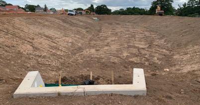 Regency Fields - installation of spillway