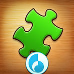 A round icon for Jigsaw Puzzle, green puzzle piece on a wood background.