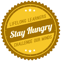 "Yellow circular badge with a wavy edge and the words inside ""Lifelong learners challenge our minds"" and a darker yellow bar across the center at an angle that says ""Stay Hungry"""