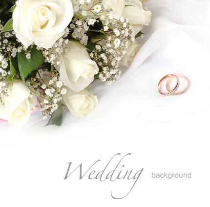 wedding rings and roses bouquet.jpg