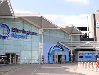 Anthea McIntyre congratulates Birmingham Airport