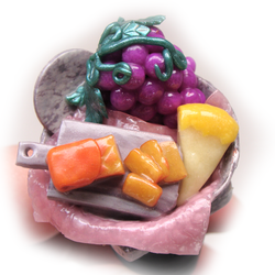 Cheese and grapes in marble bowl