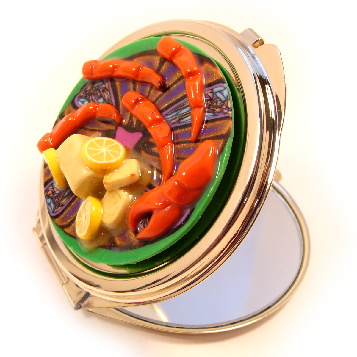 Crab claws and butter mirror compact