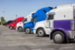 Coloful trucks lined up at a stop