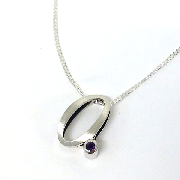 "Instagram - Little ""a"" pendant with #amethyst in #silver for Maggie's niece. Blackened inside with p"