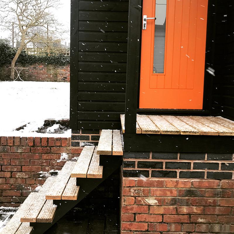 Garden studio orange door Sue Asbury