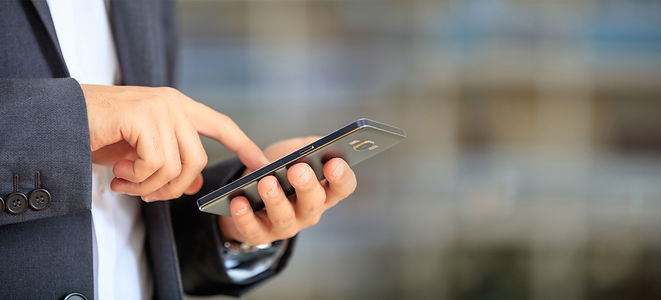 man-holding-phone-young-businessman-in-b