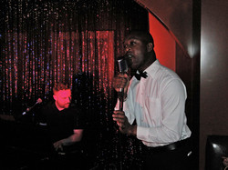 Rodney sings and bartends