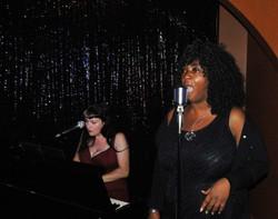 Jane sings, Rachael on piano