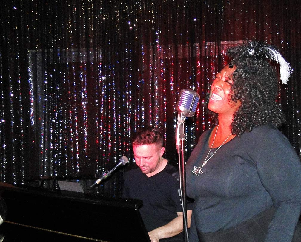 Janae catt sings with the piano
