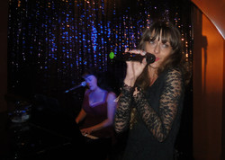 Kezia singing, Rachael on piano