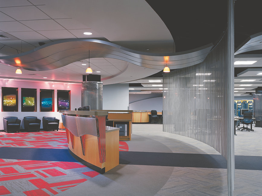 Shimmering metallic Aetna Consolidated IT Lab interior welcome desk