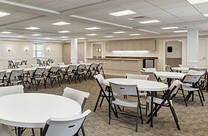 activitiy room with white tables and chairs