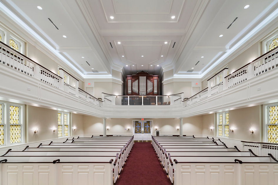 church pipe organ with white pews