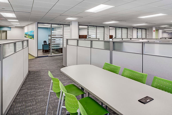 Looking at conference table with green chairs