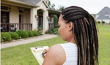 mid-adult-realtor-evaluates-a-property-f