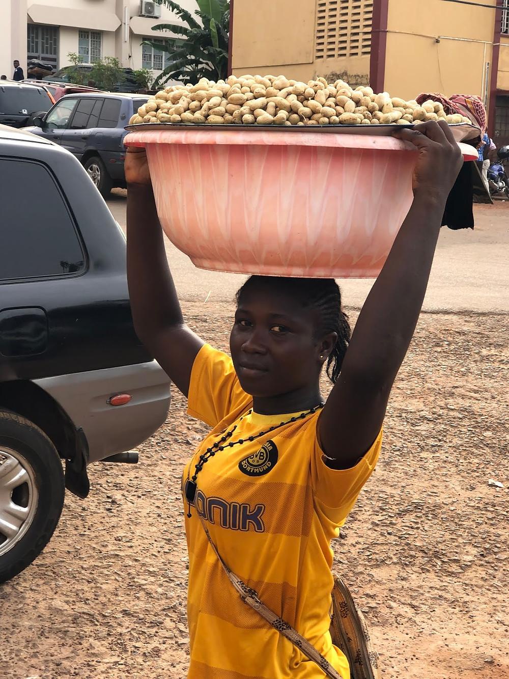 Aminatta at work - selling groundnuts for peanuts