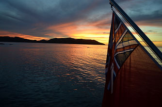 Sunset from super yacht with English flag.jpg