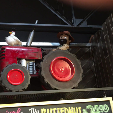 Tractor with rotating wheels