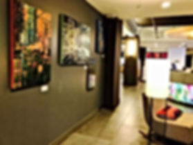 Paula Baker's paintings hang in the lobby of Downtown Houston's Aloft Hotel