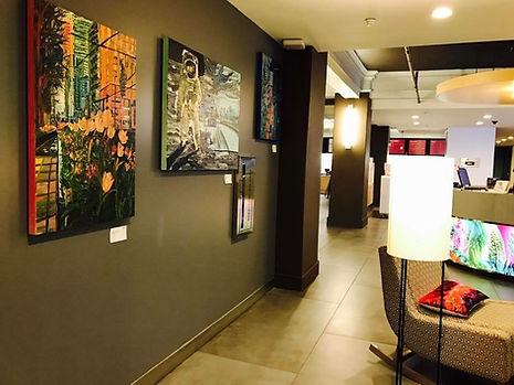 Paula Baker's paintings hang in the lobby of Downtown Houston's Aloft Hotel