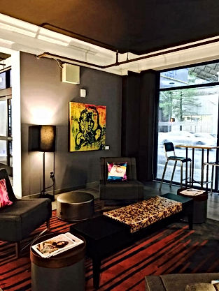Paula Baker's THE LIZARD KING hangs in Downtown Houton's Aloft Hotel, WXYZ Bar.