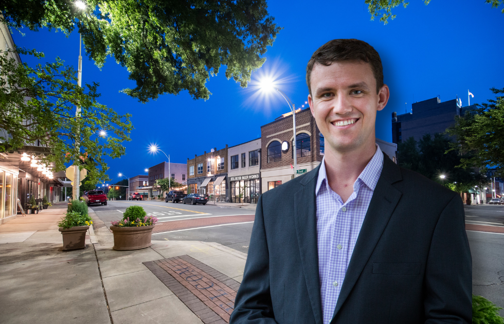 Photo of Mayor Ian Baltutis standing in Burlington, NC at night