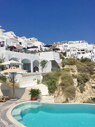 Stay in a unique cave house. View from Pezoules, Oia