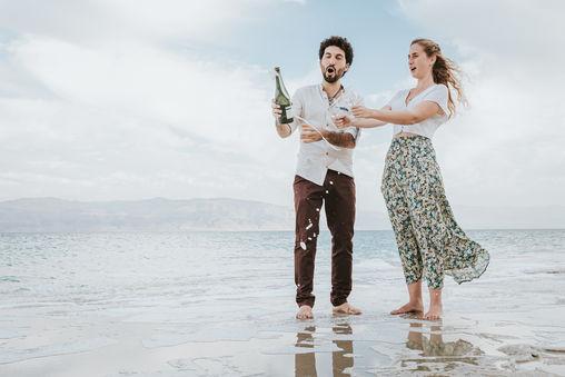Cheers by the beach | Professional AI photo edit | ImagenAI