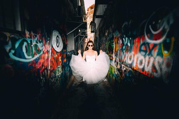 Bride with sunglasses in mural painting | ImagenAI | Professional photo edit