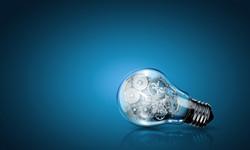 Conceptual image of light bulb with cogwheels inside.jpg