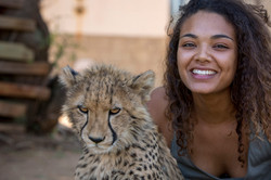 Volunteer hanging out with cheetah