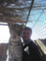 Volunteering spending time with leopard