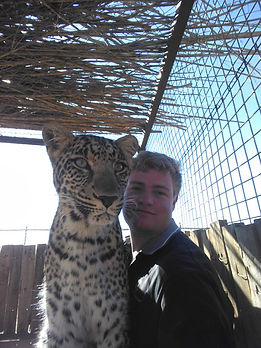 Volunteering spending time with leopard