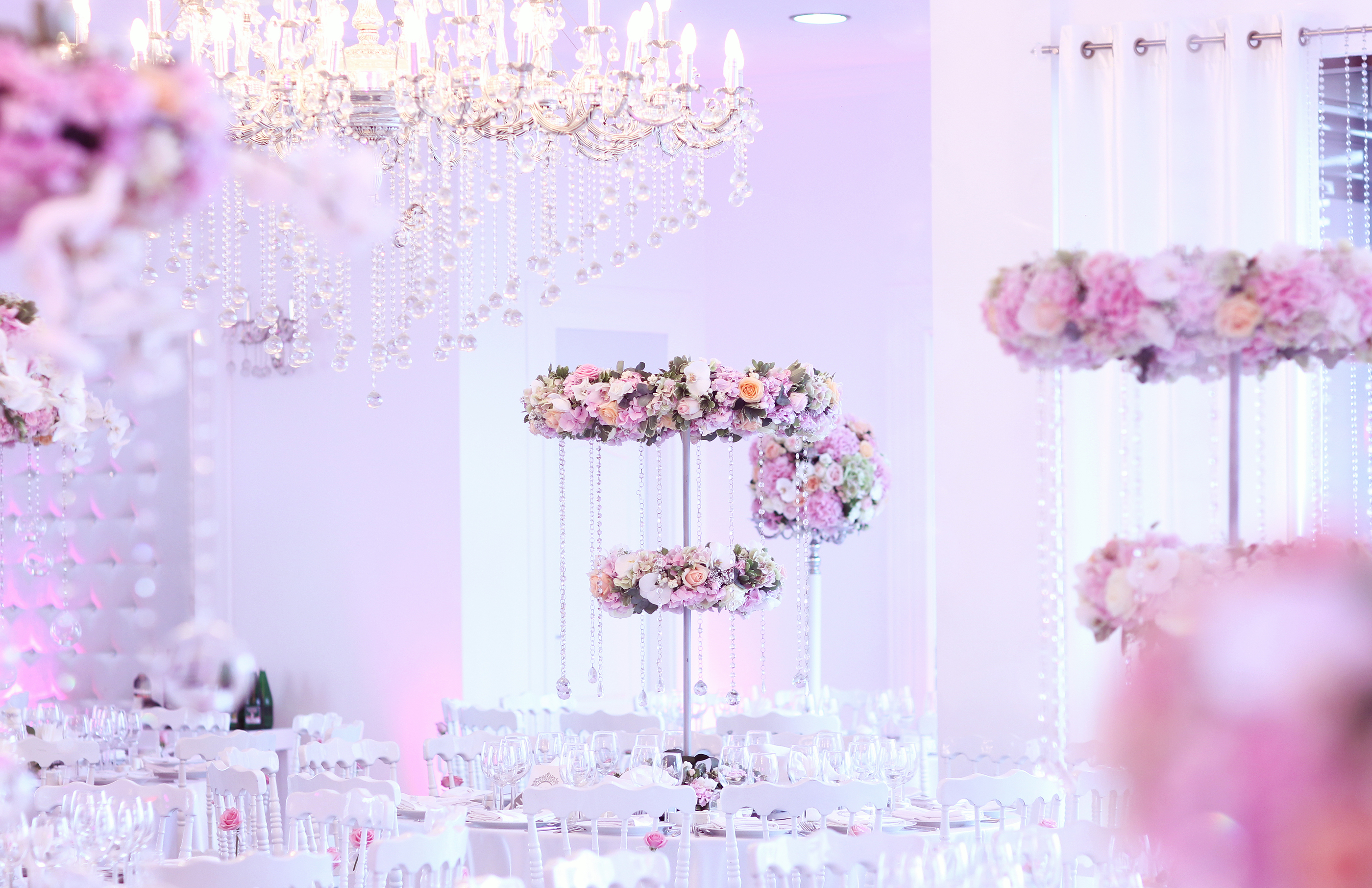 Beautiful Flower Decorations On Elegant Table With Crystal Chandelier
