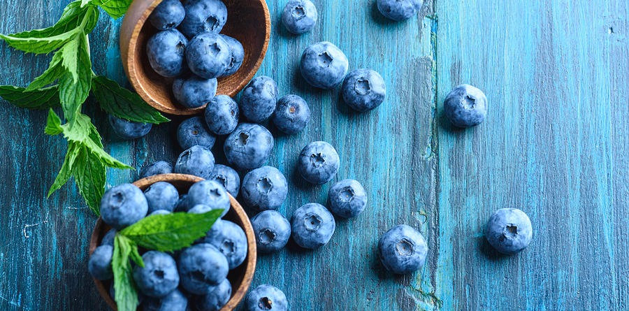 bowl-of-fresh-blueberries-on-blue-rustic