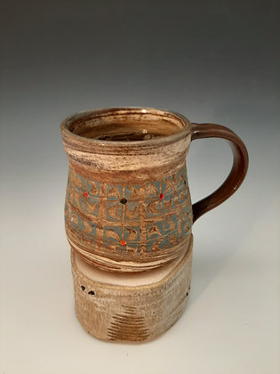 Agateware and slip mug