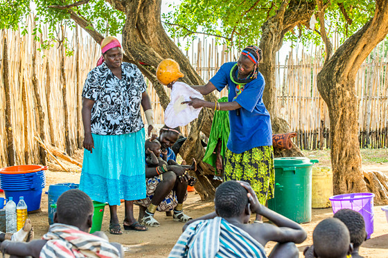 In South Sudan, a demonstration to community members on how and why to use a water filter helps prevent Guinea worm disease. In South Sudan, a demonstration to community members on how and why to use a water filter helps prevent Guinea worm disease. (Photo: The Carter Center)