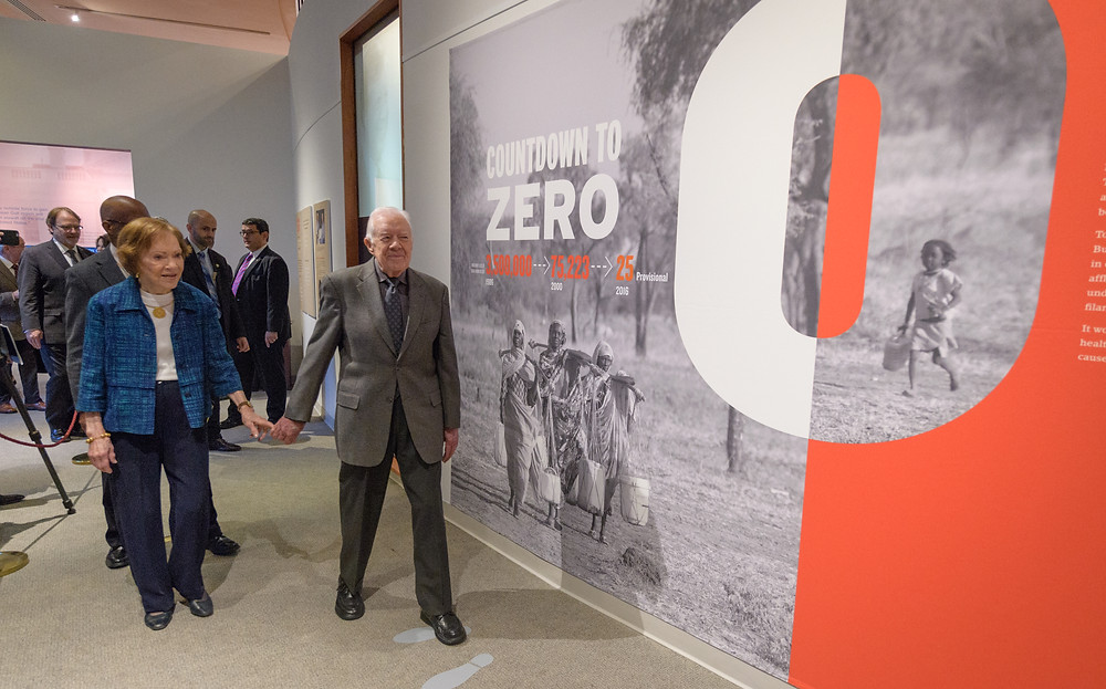 "Former President Jimmy Carter and his wife, Rosalynn, enter the new ""Countdown to Zero"" exhibition at the Jimmy Carter Presidential Library and Museum. THE CARTER CENTER/MICHAEL SCHWARZ"
