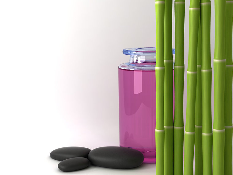 pink candle and bamboo plant
