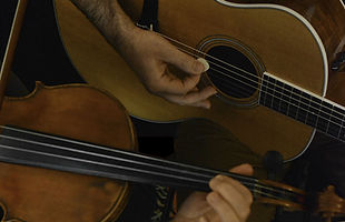 Fiddle and guitar close-up with hands