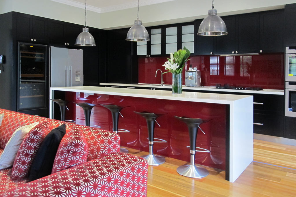 Large family kitchen with wine fridge incorporated into the cabinetry.